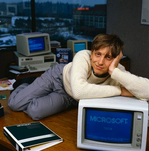 Bill Gates Reclining on Desk